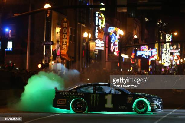 Kurt Busch performs a burnout during the Monster Energy NASCAR Cup Series Burnouts on Broadway on December 04 2019 in Nashville Tennessee