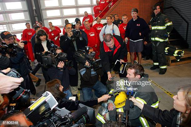 Kurt Busch the 2004 NASCAR NEXTEL Cup Series Champion answers questions from the media after meeting firemen and competing in a drill at the New York...