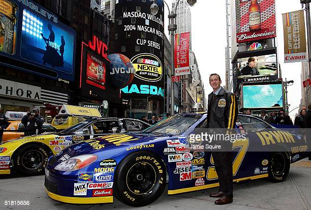Kurt Busch, the 2004 NASCAR NEXTEL Cup Series Champion poses in front of his car in Times Square as part of the NASCAR NEXTEL Cup Champions Week on...