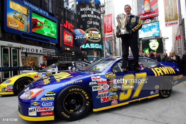 Kurt Busch the 2004 NASCAR NEXTEL Cup Series Champion poses with the NEXTEL Cup in Times Square on December 2 2004 in New York City