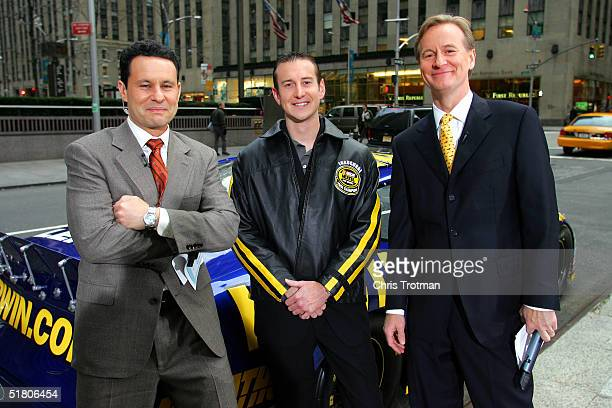Kurt Busch the 2004 NASCAR NEXTEL Cup Series Champion stands with the FOX and Friends television show anchors Brian Kilmeade and Steve Doocy on...