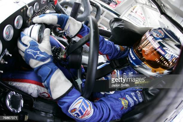 Kurt Buschdriver of the Miller Lite Dodge sits in his car before practice for the NASCAR Nextel Cup Series Autism Speaks 400 on June 1 2007 at Dover...