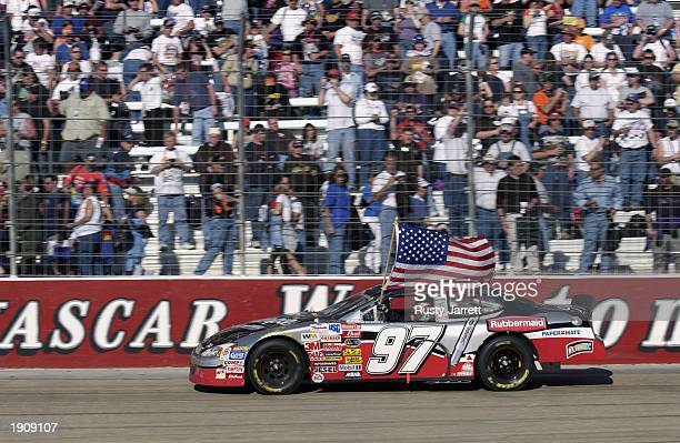 Kurt Busch,driver of the Roush Racing Rubbermaid Ford takes a victory lap after winning the NASCAR Winston Cup Food City 500 at Bristol Motor...