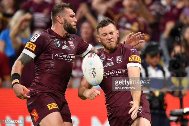 Kurt Capewell of the Maroons celebrates with team mates after scoring a try during game one of the 2021 State of Origin series between the New South...