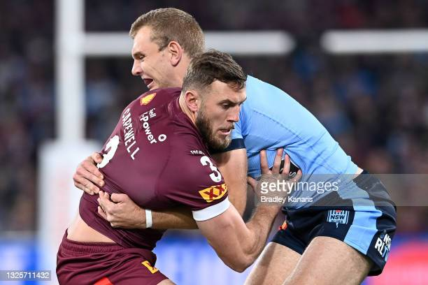 Kurt Capewell of the Maroons is tackled by Tom Trbojevic of the Blues during game two of the 2021 State of Origin series between the Queensland...
