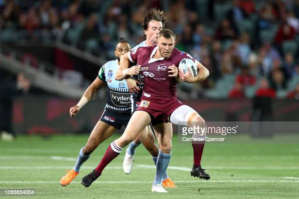 Kurt Capewell of the Maroons is tackled during game one of the 2020 State of Origin series between the Queensland Maroons and the New South Wales...