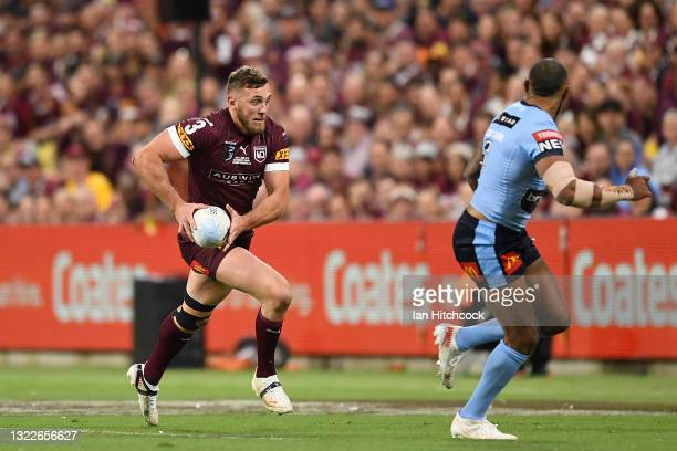 Kurt Capewell of the Maroons runs the ball during game one of the 2021 State of Origin series between the New South Wales Blues and the Queensland...