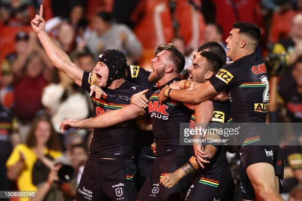 Kurt Capewell of the Panthers celebrates with team mates after scoring a try during the round three NRL match between the Penrith Panthers and the...