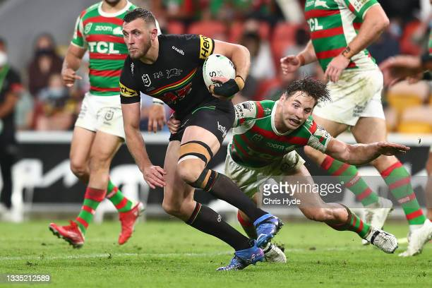 Kurt Capewell of the Panthers evades the tackle of Cameron Murray of the Rabbitohs during the round 23 NRL match between the Penrith Panthers and the...
