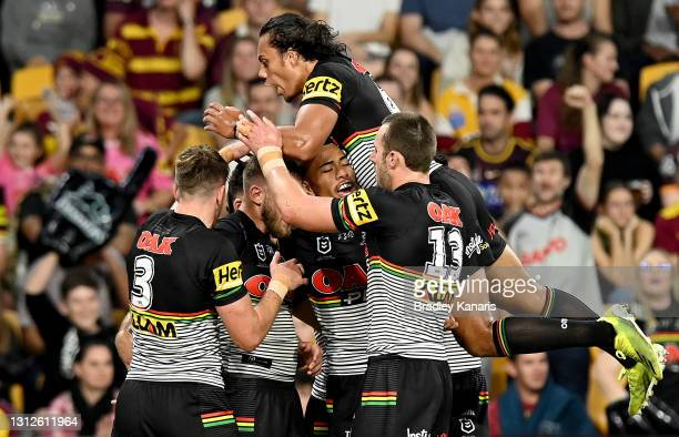 Kurt Capewell of the Panthers is congratulated by team mates after scoring a try during the round six NRL match between the Brisbane Broncos and the...