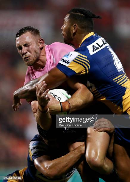 Kurt Capewell of the Panthers is tackled by Waqa Blake of the Eels during the NRL Trial Match between the Penrith Panthers and the Parramatta Eels at...