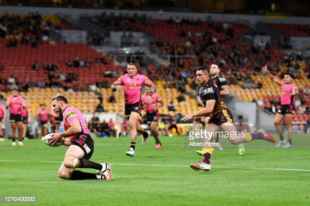 Kurt Capewell of the Panthers scores a try during the round 17 NRL match between the Brisbane Broncos and the Penrith Panthers at Suncorp Stadium on...