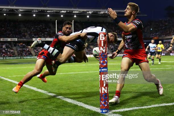 Kurt Capewell of the Sharks dives for the corner and is taken out of touch during the round 11 NRL match between the St George Illawarra Dragons and...