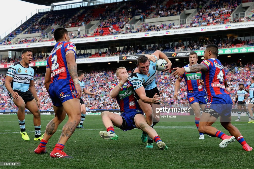 Kurt Capewell of the Sharks is tackled by the Knights defence during the round 26 NRL match between the Newcastle Knights and the Cronulla Sharks at McDonald Jones Stadium on September 3, 2017 in Newcastle, Australia.