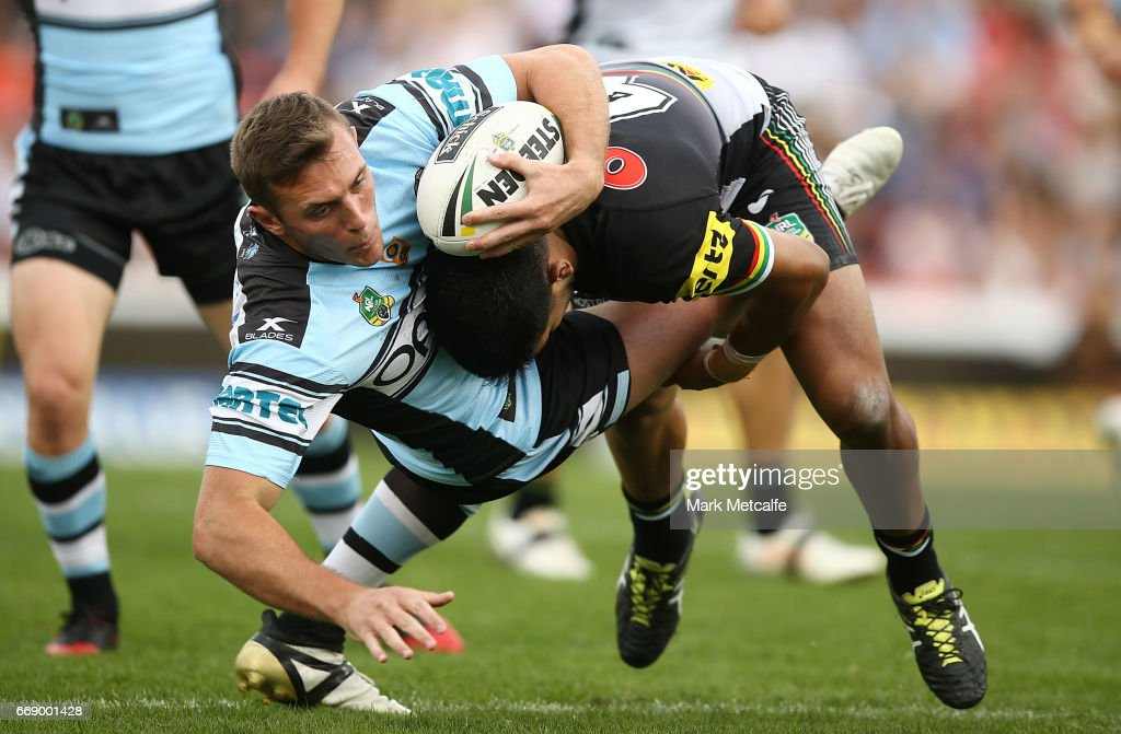 Kurt Capewell of the Sharks is tackled by Tyrone Peachey of the Panthers during the round seven NRL match between the Penrith Panthers and the Cronulla Sharks at Pepper Stadium on April 16, 2017 in Sydney, Australia.