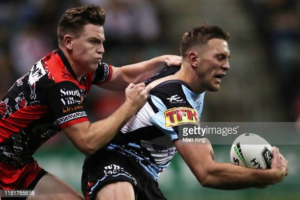 Kurt Capewell of the Sharks is tackled during the round 11 NRL match between the St George Illawarra Dragons and the Cronulla Sharks at WIN Jubilee...