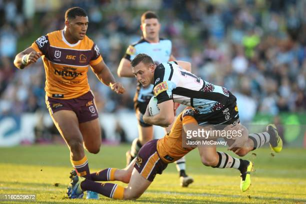 Kurt Capewell of the Sharks is tackled during the round 16 NRL match between the Cronulla Sharks and the Brisbane Broncos at Shark Park on July 07,...