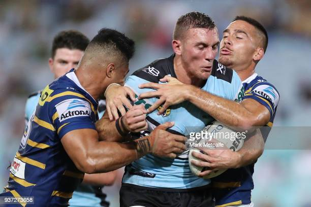 Kurt Capewell of the Sharks is tackled during the round three NRL match between the Parramatta Eels and the Cronulla Sharks at ANZ Stadium on March...