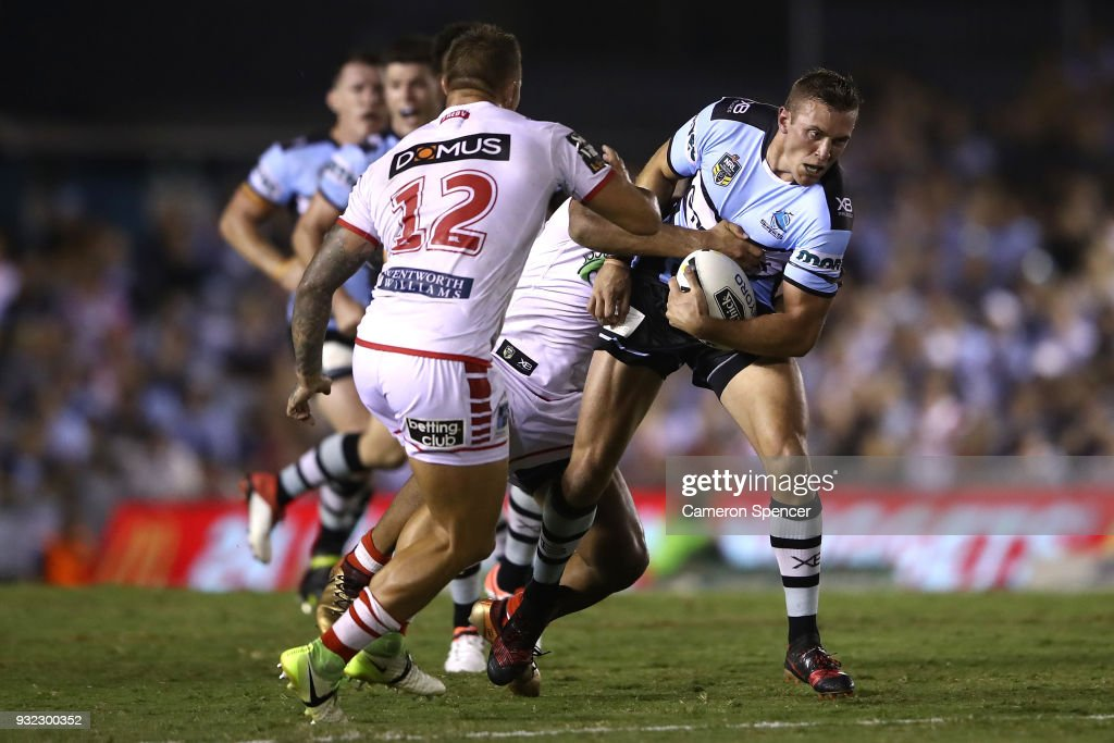 Kurt Capewell of the Sharks is tackled during the round two NRL match between the Cronulla Sharks and the St George Illawarra Dragons at Southern Cross Group Stadium on March 15, 2018 in Sydney, Australia.