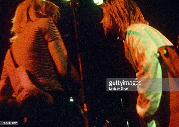 Kurt Cobain and Courtney Love both on acoustic guitar confer between songs as they perform together for Rock Against Rape benefit at Club Lingerie in...