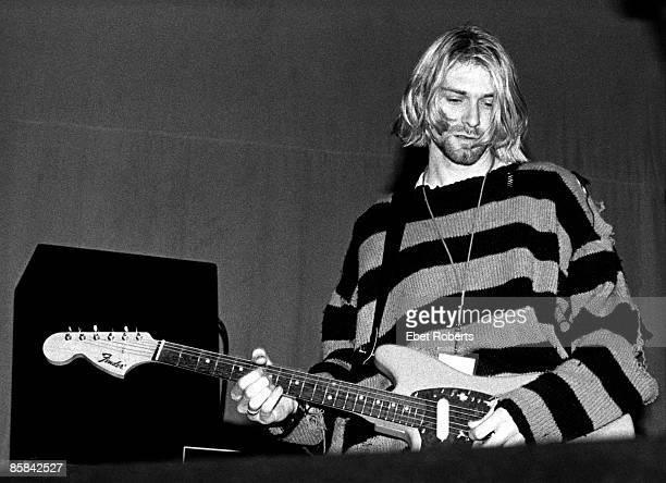 UNITED STATES JULY 23 Kurt COBAIN and NIRVANA Kurt Cobain performing live onstage at Roseland Ballroom New Music Seminar wearing stripy jumper