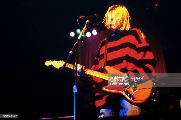 Photo of Kurt COBAIN and NIRVANA Kurt Cobain performing live onstage at Roseland Ballroom New Music Seminar wearing stripy jumper playing Fender...