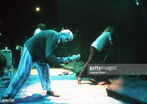 Kurt Cobain of Nirvana performs the song The Money Will Roll Right In onstage with Mudhoney and lead singer Mark Arm at the Castaic Lake Natural...