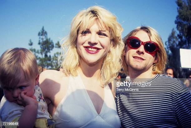 Kurt Cobain of Nirvana with wife Courtney Love and daughter Frances Bean Cobain