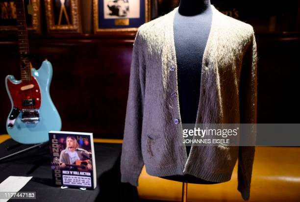 Kurt Cobain's cardigan from Nirvana's 1993 MTV Unplugged performance is on display at the Hard Rock Cafe in New York City ahead of the auction of...