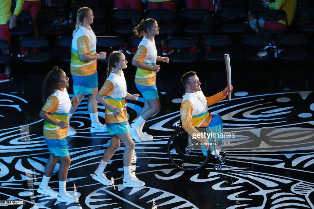 Kurt Fearnley (right) holds the Queens Baton during the Opening Ceremony for the Gold Coast 2018 Commonwealth Games at Carrara Stadium on April 4, 2018 on the Gold Coast, Australia.