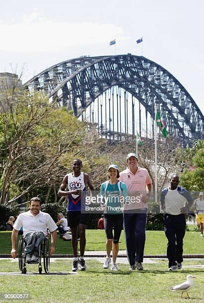 Kurt Fearnley Josphat Mwangi Antonia Kidman Glenn McGrath and Julius Seurei run during a photo call ahead of Sunday's Blackmores Sydney Running...