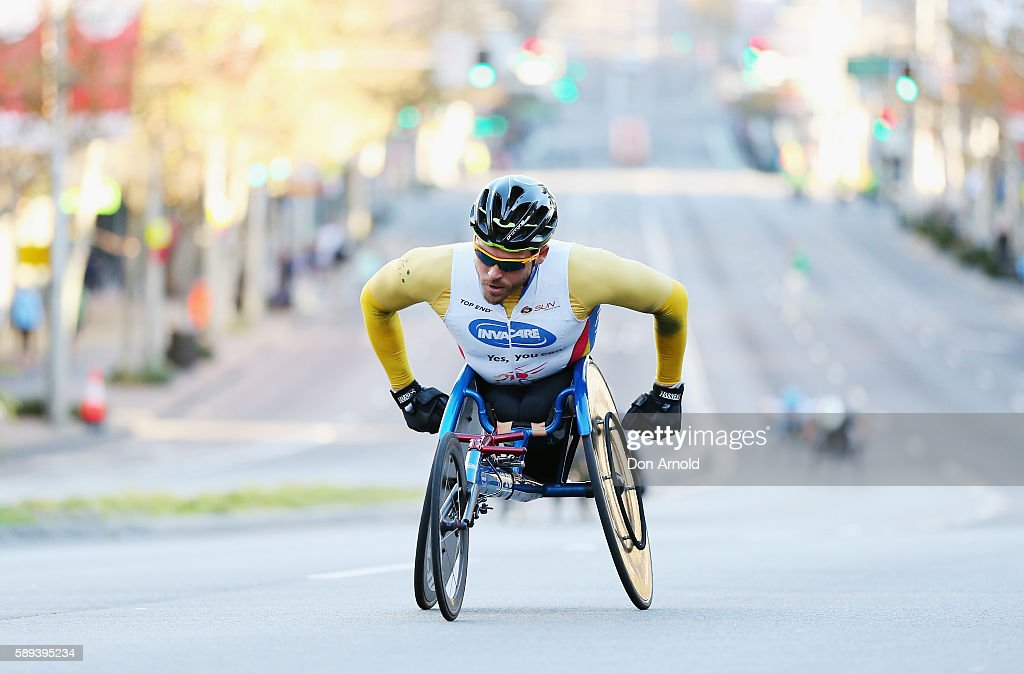Kurt Fearnley leads other competitors up William Street during the start of the 2016 City to Surf on August 14, 2016 in Sydney, Australia.