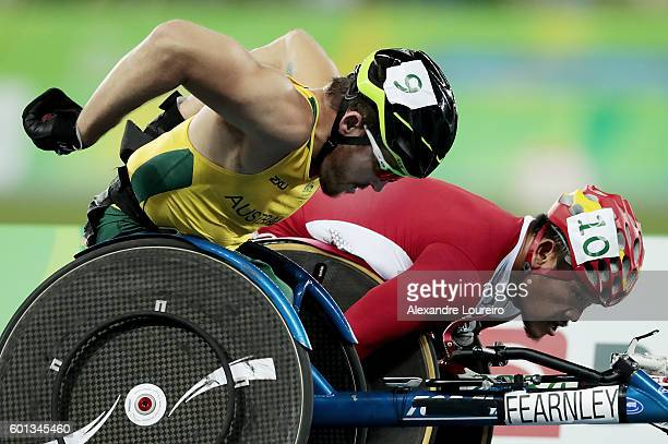 Kurt Fearnley of Australia and Rawat Tana of Thailiand compete in the Men's 5000m T54 on day 2 of the Rio 2016 Paralympic Games at the Olympic...