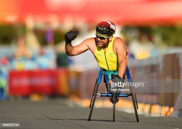 Kurt Fearnley of Australia celebrates as he races to the line to win gold in the Men's T54 marathon on day 11 of the Gold Coast 2018 Commonwealth...