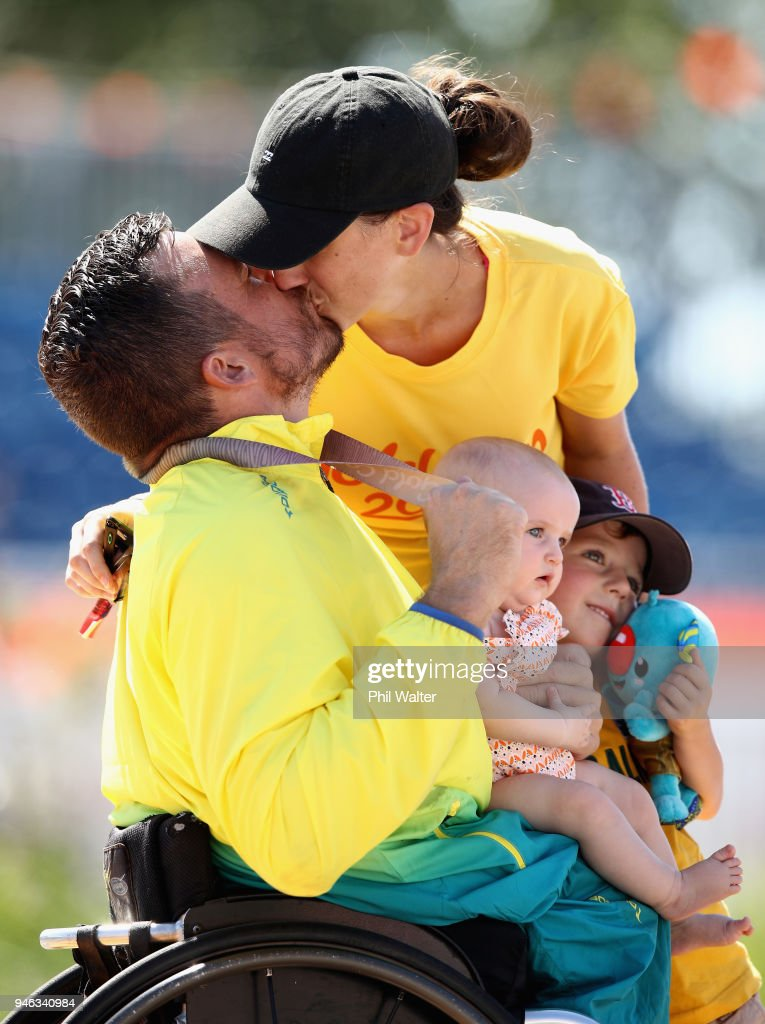 Kurt Fearnley of Australia celebrates on the podium with his Wife Sheridon, Son Harry and Daughter Emilia following gold in the men's T54 marathon on day 11 of the Gold Coast 2018 Commonwealth Games at Southport Broadwater Parklands on April 15, 2018 on the Gold Coast, Australia.