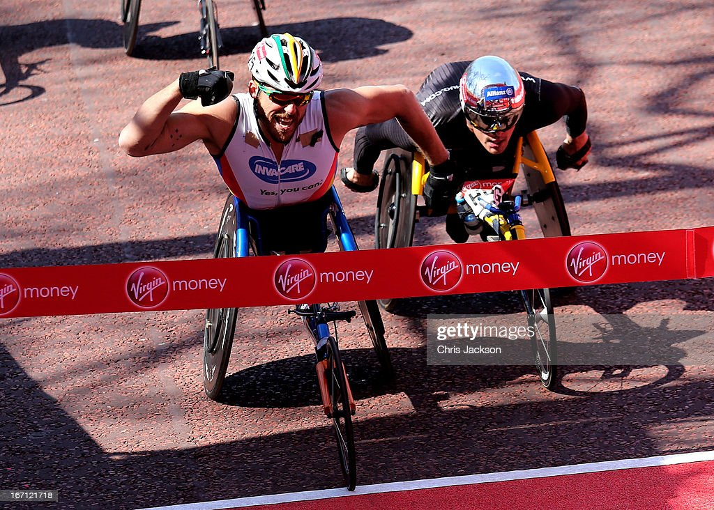 Kurt Fearnley of Australia celebrates victory as he crosses the finish line ahead of Marcel Hug of Switzerland to win the Mens Elite Wheelchair section during the Virgin London Marathon 2013 on April 21, 2013 in London, England.