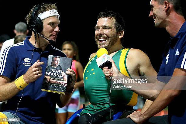 Kurt Fearnley of Australia is interviewed with his book 'Kurt Fearnley' during the 2015 Hunter Track Classic on January 31 2015 in Newcastle Australia