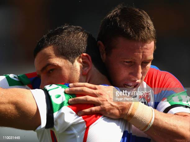 Kurt Gidley and Jarrod Mullen of the Knights celebrate a try during the round one NRL match between the Penrith Panthers and the Newcastle Knights at...