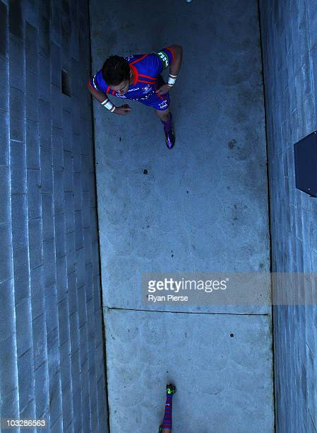 Kurt Gidley captain of the Knights leads his team out of the tunnel during the round 22 NRL match between the Newcastle Knights and the...