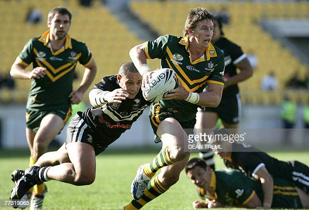 Kurt Gidley of the Kangaroos is tackled by Jeremy Smith of the Kiwis during the Centenary Test between the New Zealand Kiwi's and the Australian...