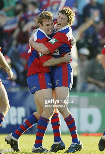 Kurt Gidley of the Knights celebrates with team mate Sean Rudder after his try during the round 21 NRL game between the Newcastle Knights and the...