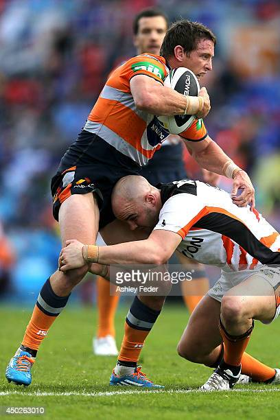 Kurt Gidley of the Knights is tackled by the Tigers defence during the round 13 NRL match between the Newcastle Knights and the Wests Tigers at...