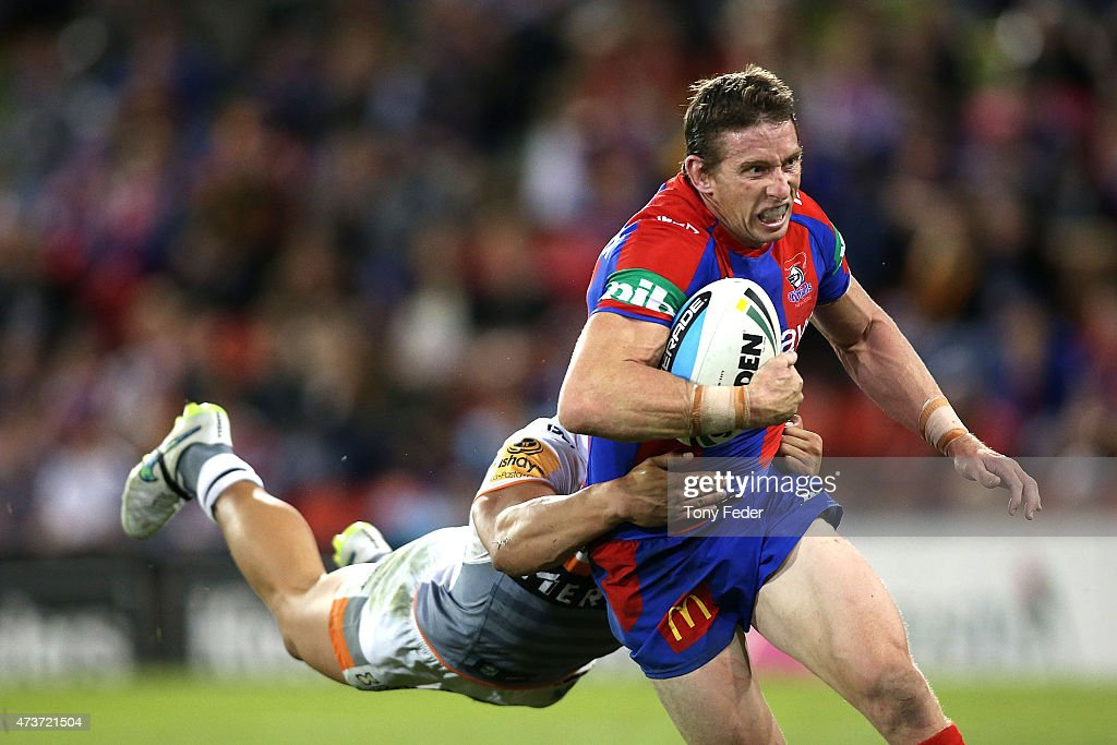 Kurt Gidley of the Knights is tackled by the Tigers defence during the round 10 NRL match between the Newcastle Knights and the Wests Tigers at Hunter Stadium on May 17, 2015 in Newcastle, Australia.