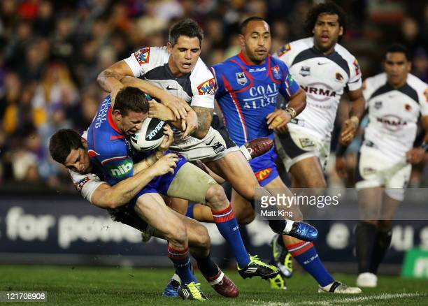 Kurt Gidley of the Knights is tackled during the round 24 NRL match between the Newcastle Knights and the Brisbane Broncos at Ausgrid Stadium on...