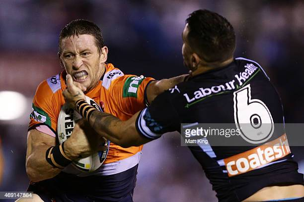 Kurt Gidley of the Knights puts a fend on Jack Bird of the Sharks during the round six NRL match between the Cronulla Sharks and the Newcastle...