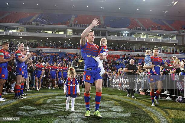 Kurt Gidley of the Knights waves to the crowd after playing his last home game for the Knights during the round 25 NRL match between the Newcastle...