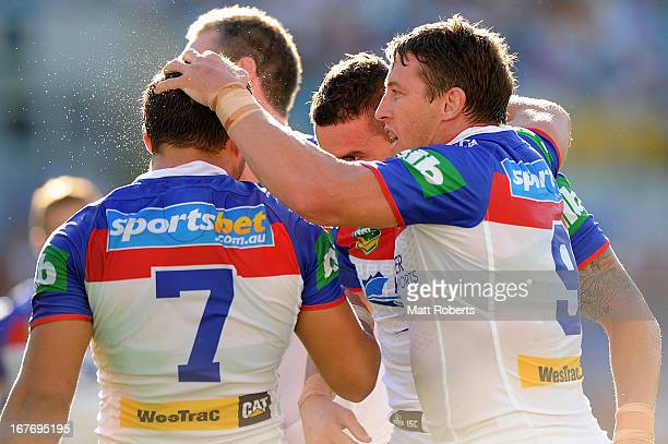 Kurt Gidley of the the Knights celebrates with team mates during the round seven NRL match between the Gold Coast Titans and the Newcastle Knights at...