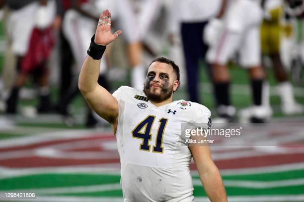 Kurt Hinish of the Notre Dame Fighting Irish waves to the fans after the College Football Playoff Semifinal at the Rose Bowl football game against...
