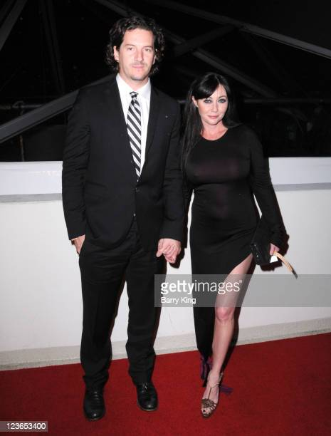 Kurt Iswarienko and actress Shannen Doherty arrive at The Weinstein Company and Realativity Media's 2011 Golden Globes after party held at Bar 210...