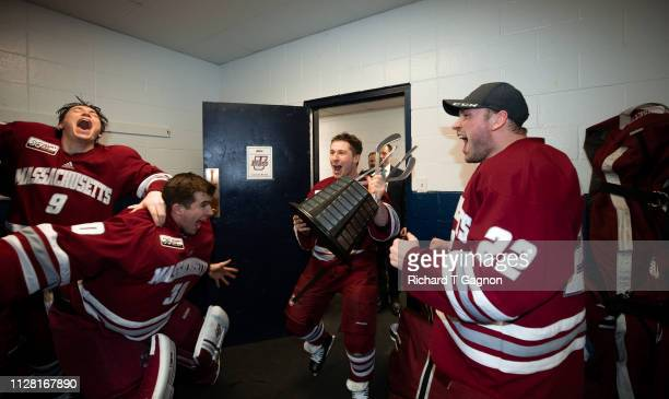 Kurt Keats of the Massachusetts Minutemen celebrates a victory against the Merrimack College Warriors after NCAA men's hockey at Lawler Rink on...